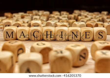MACHINES word written on wood block - stock photo