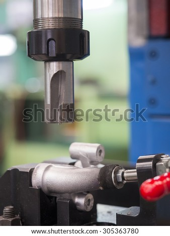 machining aluminum automotive parts by CNC machining center - stock photo