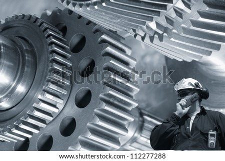 machinist, worker, with large gears and cog machinery in background, blue toning concept