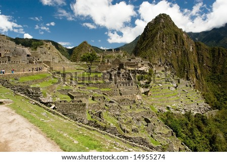 Machu Picchu  is a pre-Columbian Inca site located 2,400 meters (7,875 ft) above sea level. It is situated on a mountain ridge above the Urubamba Valley in Peru