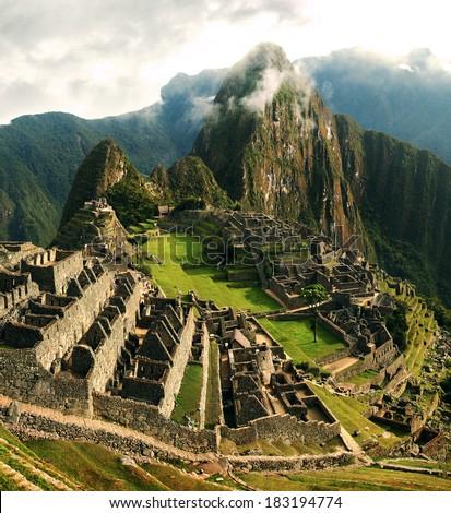 Machu Picchu is a 15th-century Inca site located 2,430 metres (7,970 ft) above sea level. It is located in the Cusco Region, Urubamba Province, Machupicchu District in Peru. - stock photo