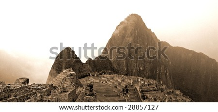 Machu Picchu on a cloudy day - stock photo