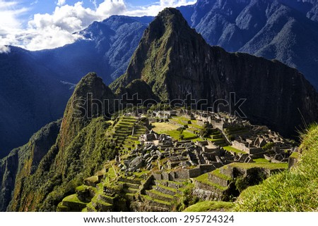 MACHU PICCHU, PERU - MAY 31, 2015: View of the ancient Inca City of Machu Picchu. The 15-th century Inca site.'Lost city of the Incas'. Ruins of the Machu Picchu sanctuary. UNESCO World Heritage site. - stock photo