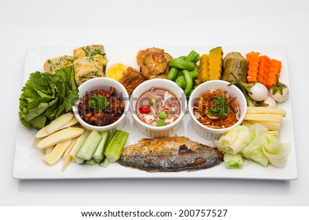 Mackerel boiled vegetables and sauces.