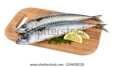 mackerel fish on wooden plate isolated - stock photo