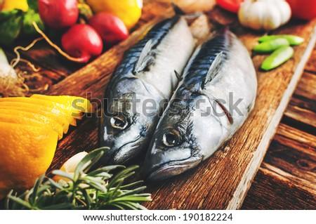 Mackerel on wooden plate - stock photo