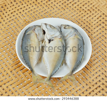 Mackerel steamed in plate on top of bamboo basket. - stock photo
