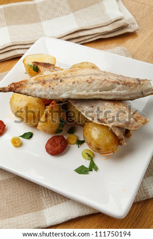Mackerel with potato and chorizo salad
