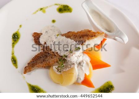 mackerel with sauce on white plate - stock photo