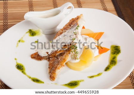 mackerel with sauce on white plate