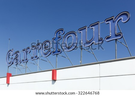 Macon, France - September 21, 2015: Carrefour sign on a facade.  Carrefour is a french multinational retailer headquartered in France and it is one of the largest hypermarket chains in the world. - stock photo