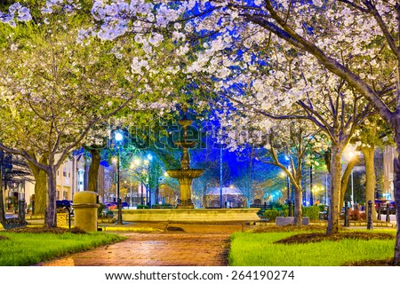 Macon, Georgia, USA downtown with spring cherry blossoms at Dunlap Park. - stock photo