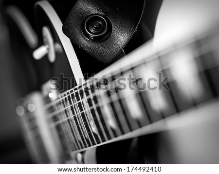 Macro abstract black and white photo of the neck and frets of an electric guitar.  - stock photo