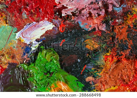 macro artist's palette, texture mixed oil paints in different colors and saturation studio - stock photo
