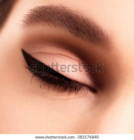 Macro beautiful female eye with long eyelashes . Sexy look sensual look . Female eye with long eyelashes . Eyelash extensions . perfect makeup