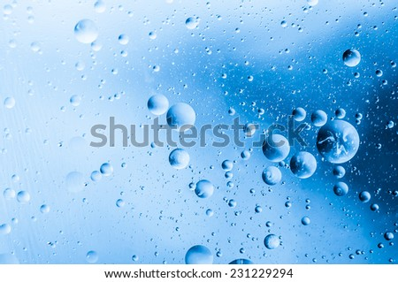 Macro bubbles of water on blue background