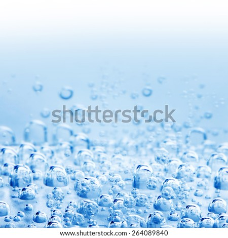 Macro bubbles of water on blue background - stock photo