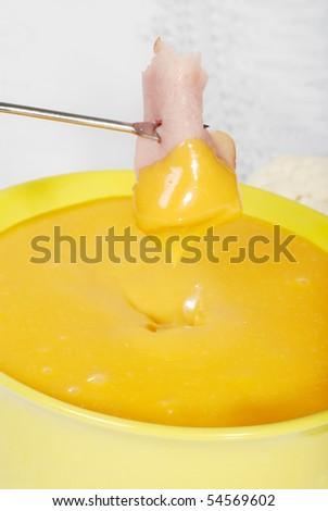 macro cheese and ham fondue - stock photo