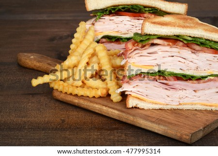 macro chicken club sandwich with fries