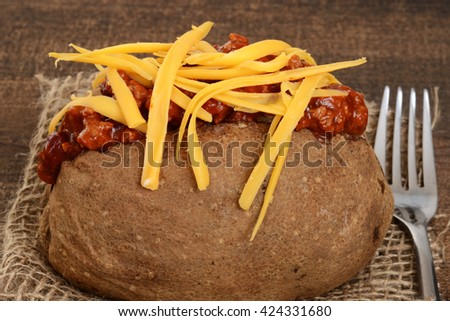macro chili cheese baked potato - stock photo