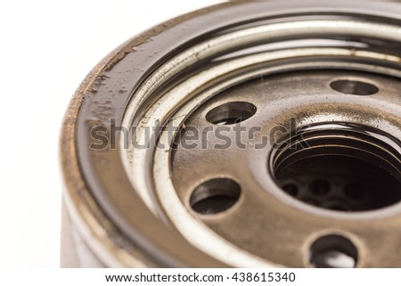 Macro close up car oil filter over white background - stock photo