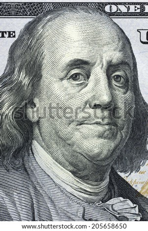 Macro close up of Ben Franklin's face on the US $100 dollar bill. - stock photo