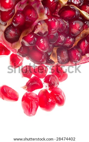 macro close-up of cut red fresh pomegranate in white background