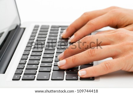 Macro close up of female hands on laptop keyboard. - stock photo