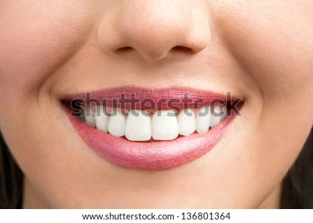 Macro close up of female smile showing healthy white teeth. - stock photo