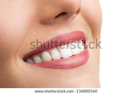 Macro close up of perfect female teeth isolated on white. - stock photo
