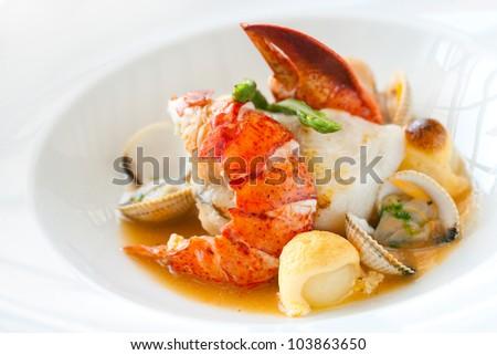 Macro close up of seafood dish lobster and shellfish. - stock photo