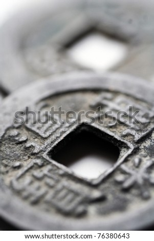 macro close-up of two ancient china coins, selective focus on closer coin