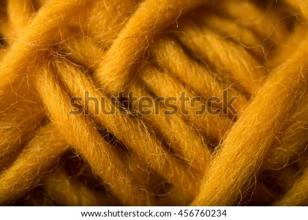 Macro Close up of Wool Yarn in Mustard Yellow Color  - stock photo