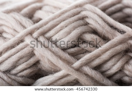 Macro Close up of Wool Yarn Treads in Beige Color  - stock photo