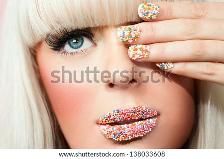Macro close up portrait of young blond woman with fantasy make up. - stock photo