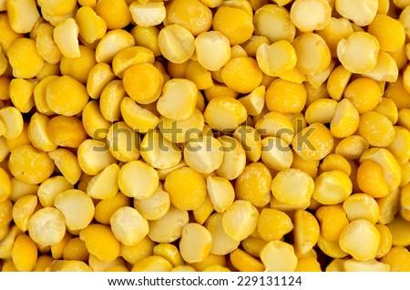 Macro closeup background texture of yellow chana split peas - stock photo
