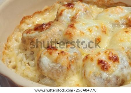 macro delicious meatballs baked in a creamy sauce - stock photo