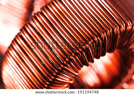 Macro detail of a copper inductor in a transformer  - stock photo
