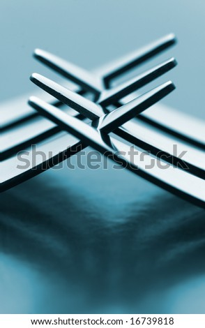 macro detail of a couple of silverware forks - stock photo