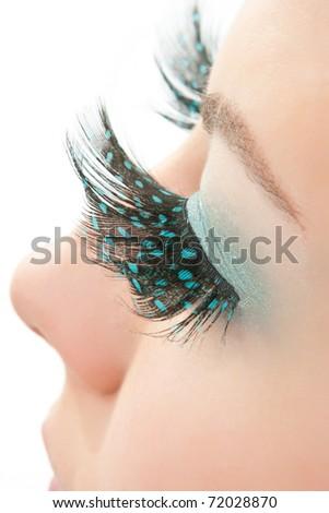 Macro eye of a woman with long feather false eyelashes. - stock photo
