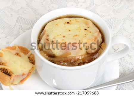 macro french onion soup with cheese bread - stock photo