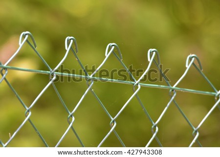 Macro from a wire fence - stock photo