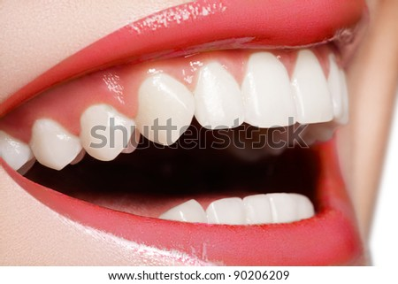 Macro happy woman's smile with healthy white teeth, bright red gloss lips make-up. Stomatology and beauty care - stock photo