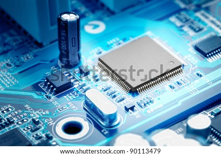 macro image electronic circuit board with processor - stock photo