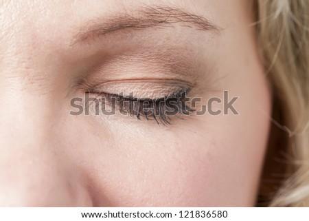 Macro image of a close eye of a woman - stock photo