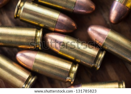 Macro image of a group of 9mm bullets.