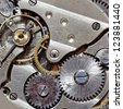 Macro image of a metallic mechanical watch component. - stock photo