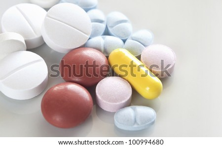 Macro image of a variety of medicinal pills and tablets.