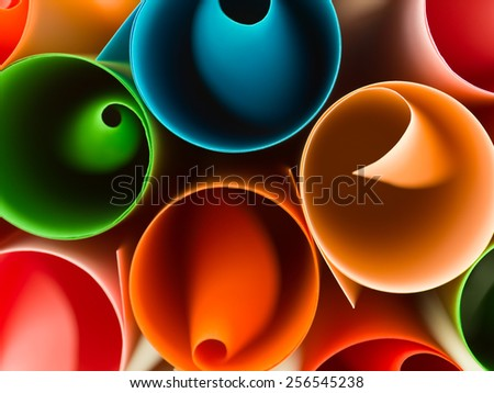 macro image of colorful rolled up paper. abstract pattern - stock photo