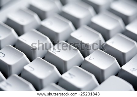 Macro image of white buttons of computer keypad with letters and symbols on them